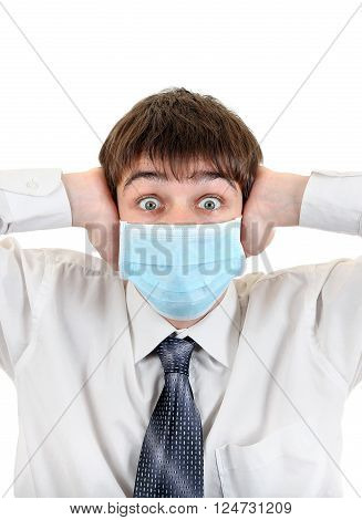Shocked Teenager in Flu Mask Covering his Ears Isolated on the White Background