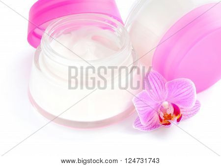 Face Creams And Beautiful Orchid Flowers On White Background