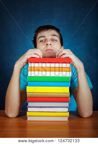 Tired Student with the Book on the Blue Background
