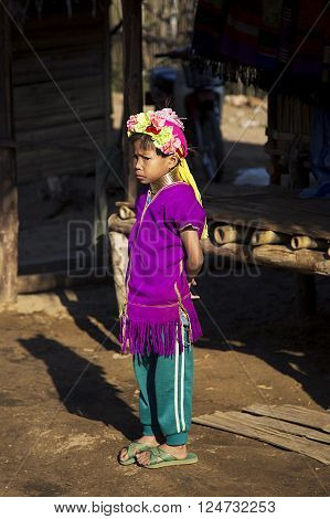 CHIANG MAI, THAILAND - FEBRUARY 02, 2016: Unidentified girl from Karen Long Neck Village near Chiang Mai Thailand. This village is a part of very popular Hill tribe tourism in Thailand.
