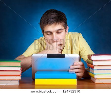 Pensive Student with the Book and Tablet Computer