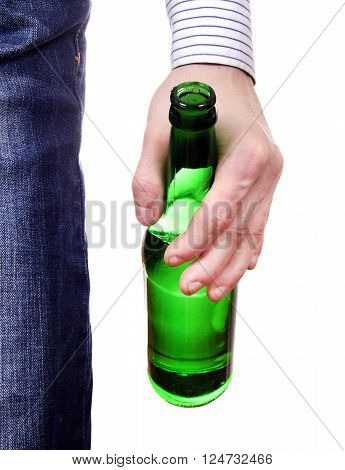 Beer Bottle in the Hand closeup on the White Background