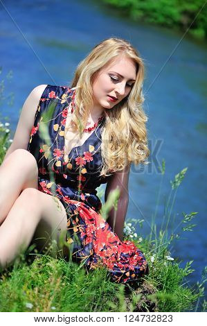 Young Pretty Woman Relaxing On The River