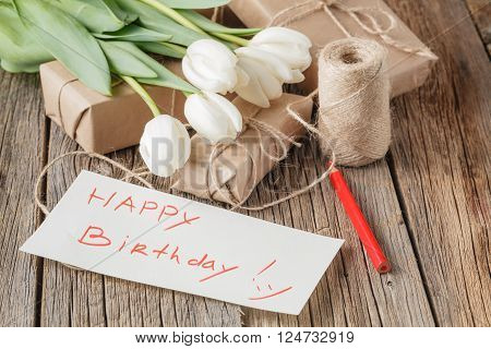 Happy Birthday Mesage With Flowers On Rustic Table With Flowers
