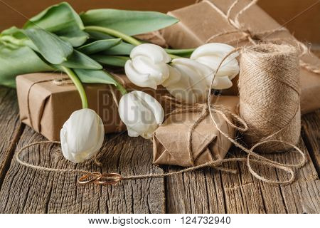 White Flowers Tulip On Present Box On Table