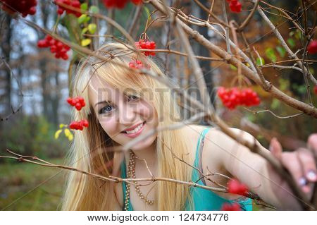 Portrait Of A Beautiful Girl Near The Red Viburnum