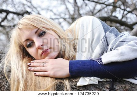 Portrait young beautiful woman in autumn park
