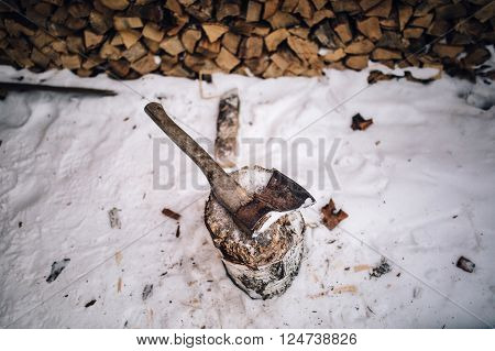 firewood. old rusty ax winter. in willage