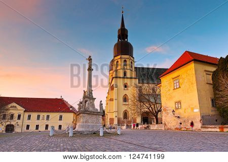 Monument and a church of saint Nicolaus in centre of Trnava, Slovakia.