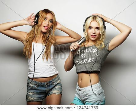 Beauty girls with a microphone singing and dancing