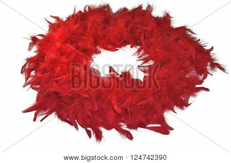Red fluffy feather boa coiled isolated on white background - vintage ladies' accessory