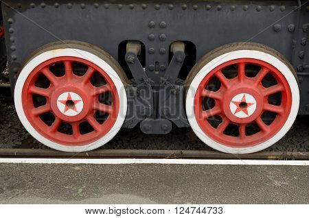 red wheels of steam locomotive-chassis vehicle.Museum of transport in St. Petersburg.