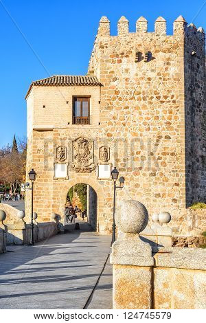 TOLEDO, SPAIN - MARCH 23, 2016: Puente de San Martin is a medieval bridge across the river Tajo in Toledo Spain. The bridge was constructed in the late 14th century.