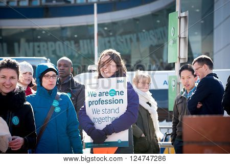 Liverpool, United Kingdom - April 6, 2016: Junior doctors are striking in England today against planned government changes to their pay and working conditions, changes they claim are unfair and unsafe