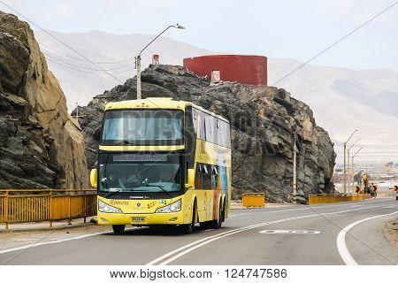 CHANARAL, CHILE - NOVEMBER 18, 2015: Yellow intercity coach Modasa Zeus at the interurban freeway.