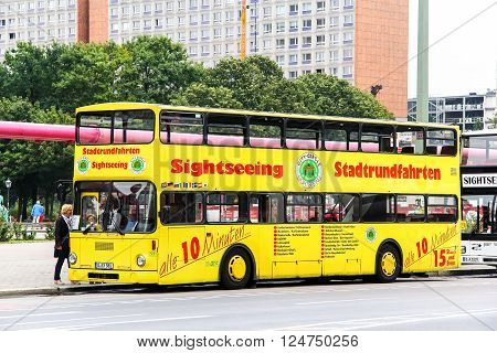 BERLIN, GERMANY - SEPTEMBER 12, 2013: City sightseeing bus MAN SD200 in the city street.