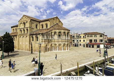 MURANO, VENICE, ITALY - APRIL 24, 2015: Tourist people walking around The Church of Santa Maria e San Donato is a religious edifice located in Murano northern Italy. The church is one of the oldest in the Venetian lagoon.