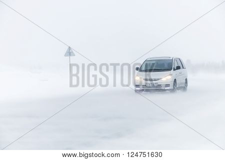 NOVYY URENGOY, RUSSIA - MARCH 20, 2016: Family van Toyota Previa at the interurban freeway during a heavy northern blizzard.