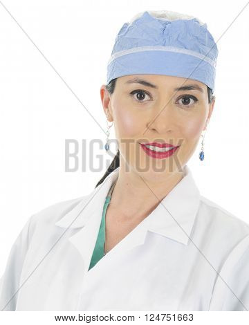 A pretty female surgeon in her surgical cap and a lab coat over her scrubs.  On a white background.