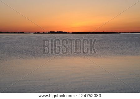 Reflection of the sunset in calm waters of a lowland river (Northern Dvina) Arkhangelsk Russia