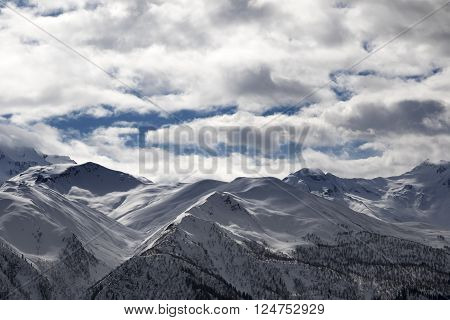 View on snowy mountains and cloudy sky in evening. Caucasus Mountains. Svaneti region of Georgia.