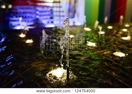 Selective focus point on fountain at night scene