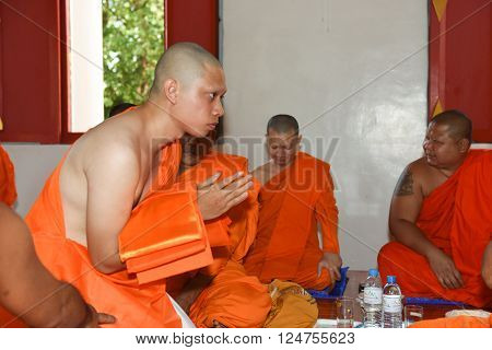 Nakhonnayok-Thailand ,July 3 : Shaved ordained Buddhist ceremony in Thailand. Thai man gets his head shaved JULY 3 , 2015