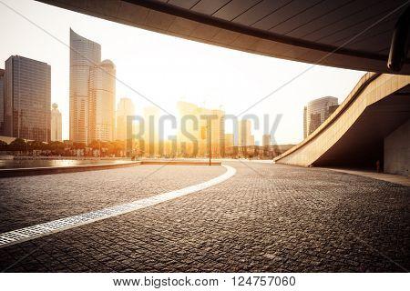 empty asphalt road near modern building in hangzhou