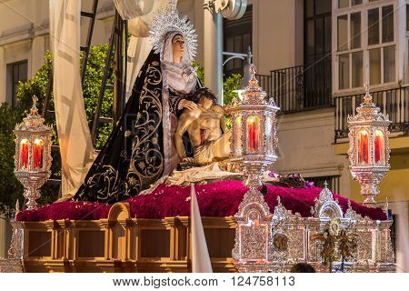 San Fernando, Spain - March 31, 2015: Holy Week in San Fernando Cadiz Spain. Brotherhood of charity during the procession of Easter.