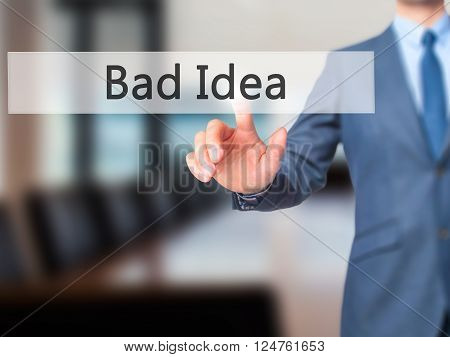 Bad Idea - Businessman Hand Pressing Button On Touch Screen Interface.