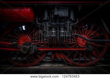 big dark red german steam train wheels