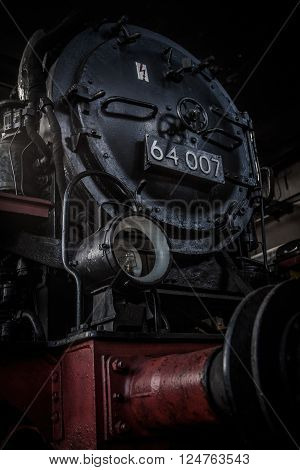 SCHWERIN - GERMANY - FEBRUARY 2015: a german dark red locomotive steam boiler on february 2015