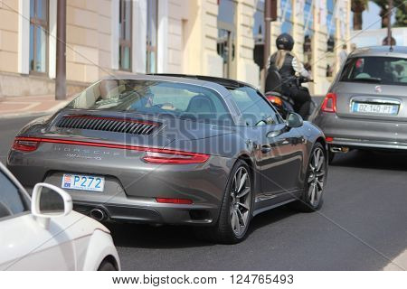 Monte-Carlo Monaco - April 6 2016: Porsche 911 Targa 4S on Avenue d'Ostende in Monaco. Man Driving an Expensive Gray Porsche 911 Targa 4S in the south of France