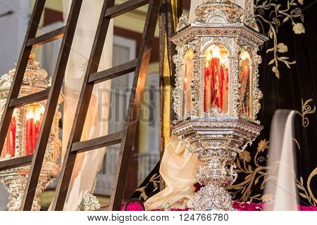 San Fernando, Spain - March 31, 2015: Holy Week in San Fernando Cadiz Spain. Detail of the passage of the brotherhood of charity during the procession of Easter