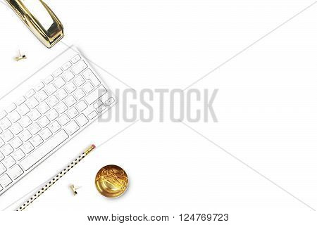 Flat lay office white desk and keyboard with gold stationery. Gold stapler stripe gold pattern pencil. Floral tulip. View top. Table up. Mock-up background