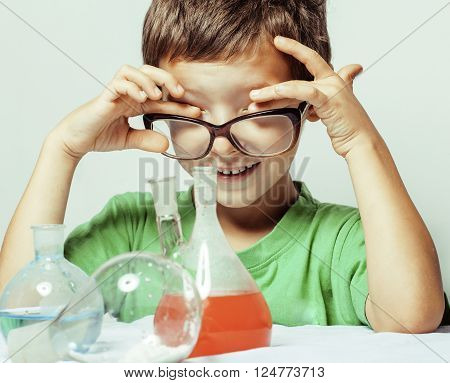 little cute boy with medicine glass isolated wearing glasses smiling close up genius kid, lifestyle people science concept