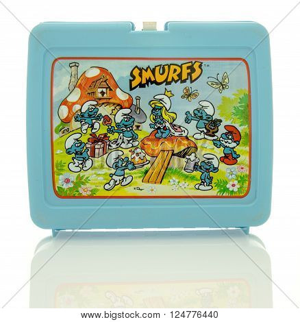 Winneconne, WI - 6 April 2016:  Plastic lunch box featuring Smurfs on an isolated background.