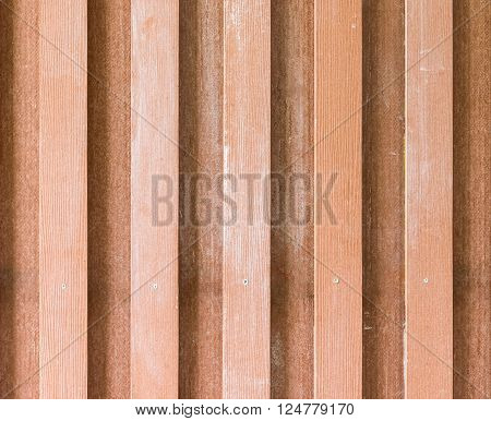 Double layer lath on the wooden fence of the countryside house.