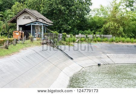 Low pressure pumping plant near the reservoir for countryside farm.