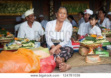 Bali Indonesia Apr 4, 2016 : Balinese family in traditional costume attending Meprani Ceremony at tample in Batur. Meprani is one of the Hindu ceremony in Bali Island Indonesia.