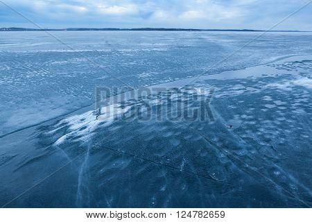 Ice melting in lake landscape at dusk