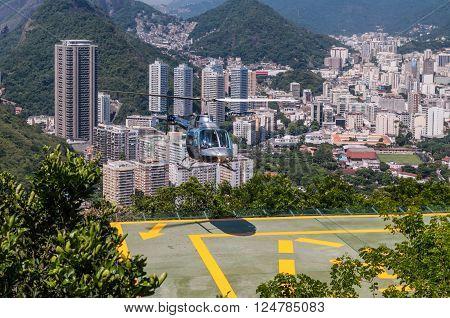 Rio de Janeiro Brazil - December 21 2012: The Rio de Janeiro Helicopter Tour in Rio de Janeiro Brazil. Rio de Janeiro is seen in the background.