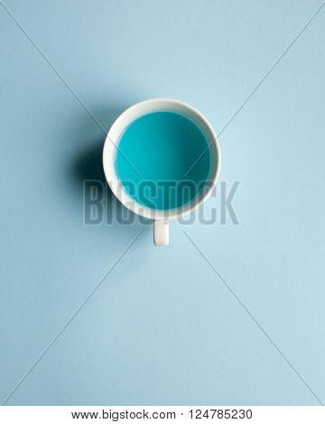 Blue water cup. Free space for text.
