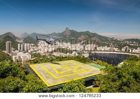Rio de Janeiro Brazil - December 21 2012: The Rio de Janeiro Helicopter Tour in Rio de Janeiro Brazil. Corcovado and Christ the Redeemer statue is seen in the background.