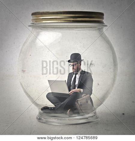 English businessman inside jar