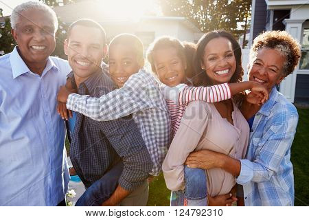 Black multi generation family outside, backlit portrait