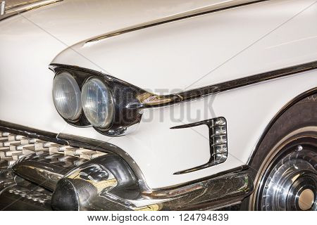HALTERN NRW GERMANY - FEBRUARY 1 2016: Detail US Car of the 50s headlight of a classic car at an exhibition.