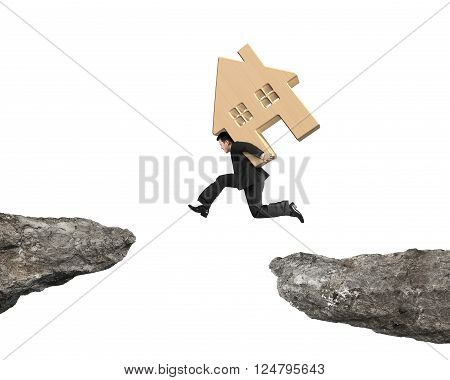 Man Carrying Wooden House Jumping Over Two Cliffs