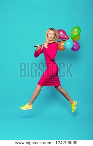 Blonde Woman With Balloons On Blue