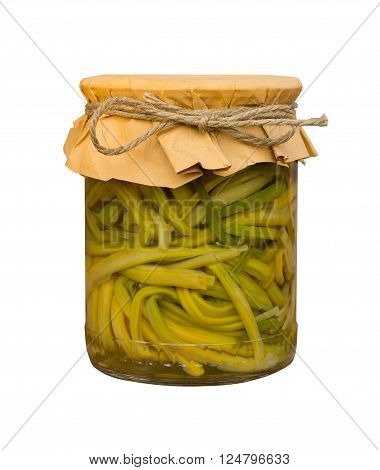 pickled garlic sprouts in a glass jar isolated on white background. home canning
